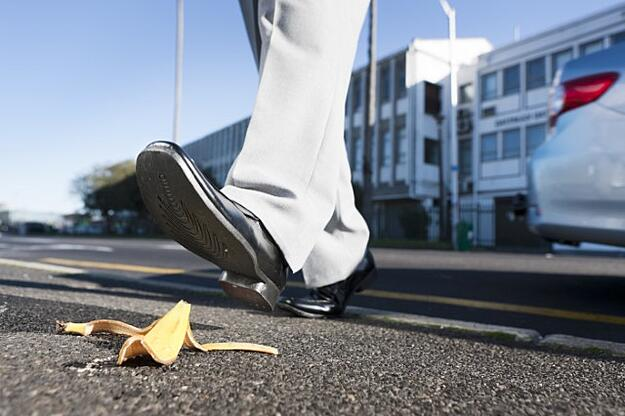Photo of banana on the street, foot stepping on it. Why PL/SQL fitness is important. Toad.